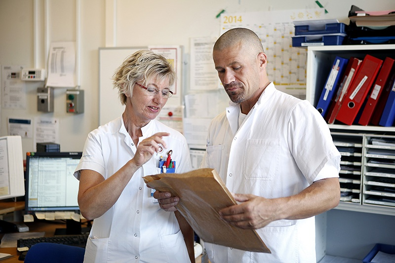 Nurse and service staff review planned tasks